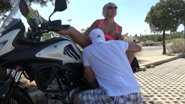 Hot chick masterbating on a motorcycle